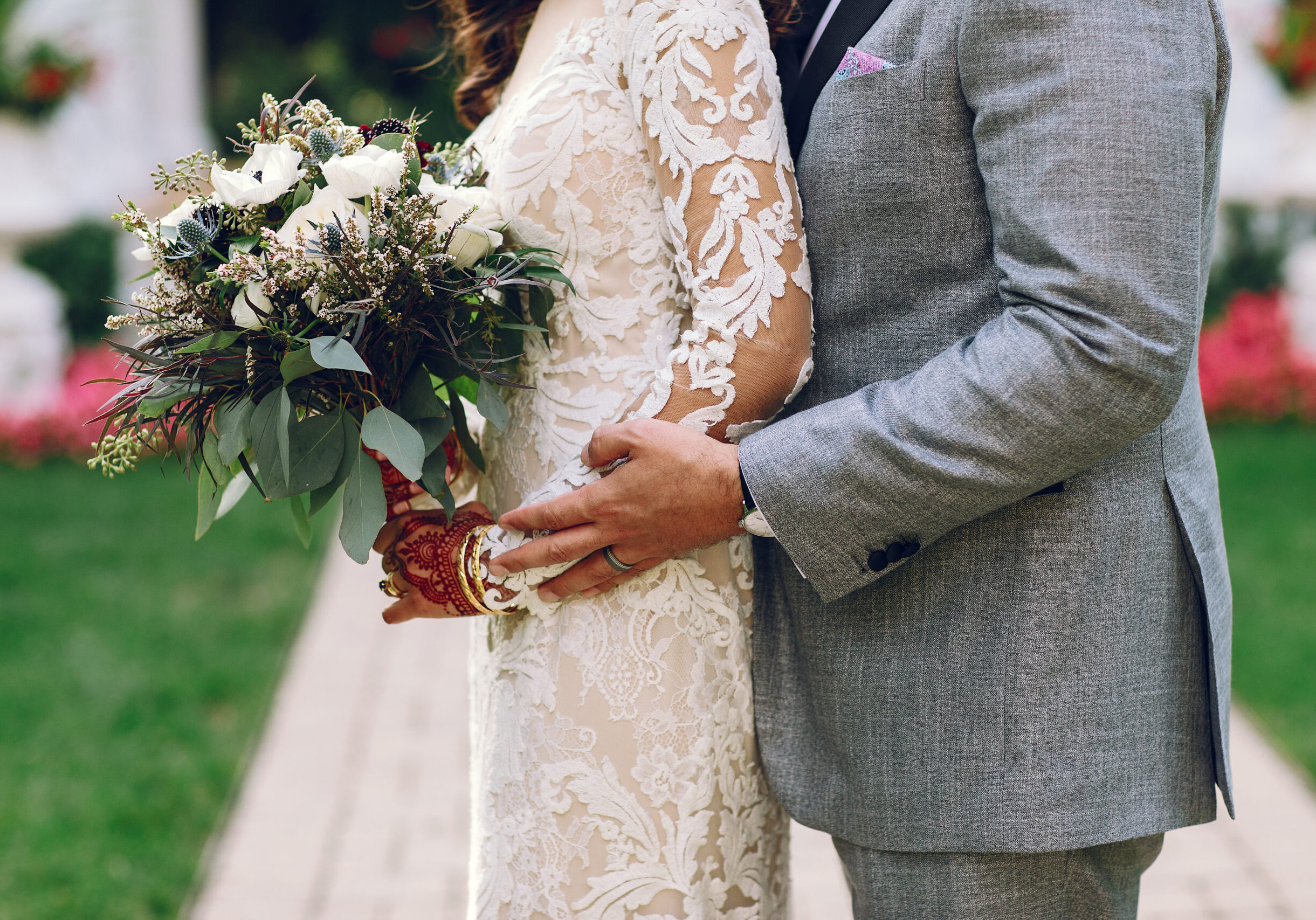 Beautiful bride. Handsome fiance in a gray suit. Couple in a park